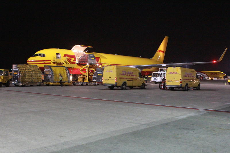 Unloading one of 40 planes scheduled for departure each night.