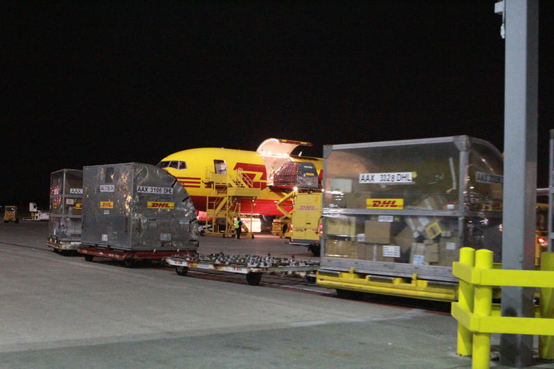 Cargo carriers shaped to fit sections of aircraft are transported inside for sorting.
