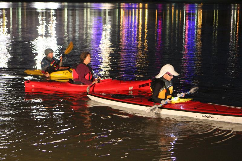 Kayakers put in near the base of the Suspension Bridge early Thursday.