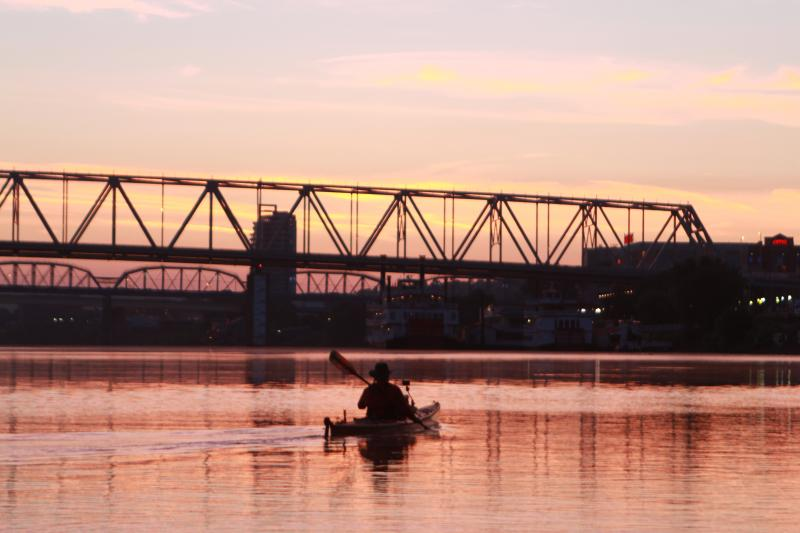 Ted Denman of Edgewood paddles to greet the sun in Thursday morning's beginning of Paddlefest 2013.