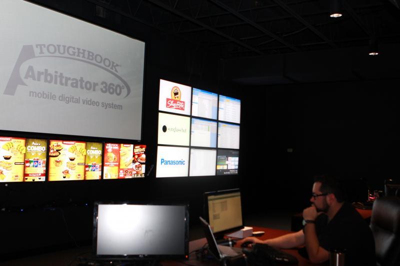 An employee of Top Gun Sales Performance takes help desk calls for Panasonic's Arbitrator.