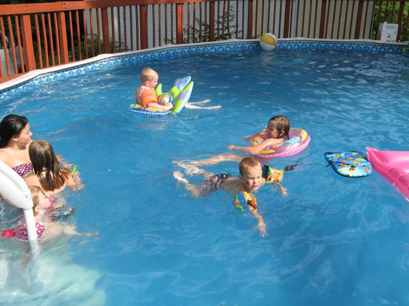 Children cool off in a backyard pool.