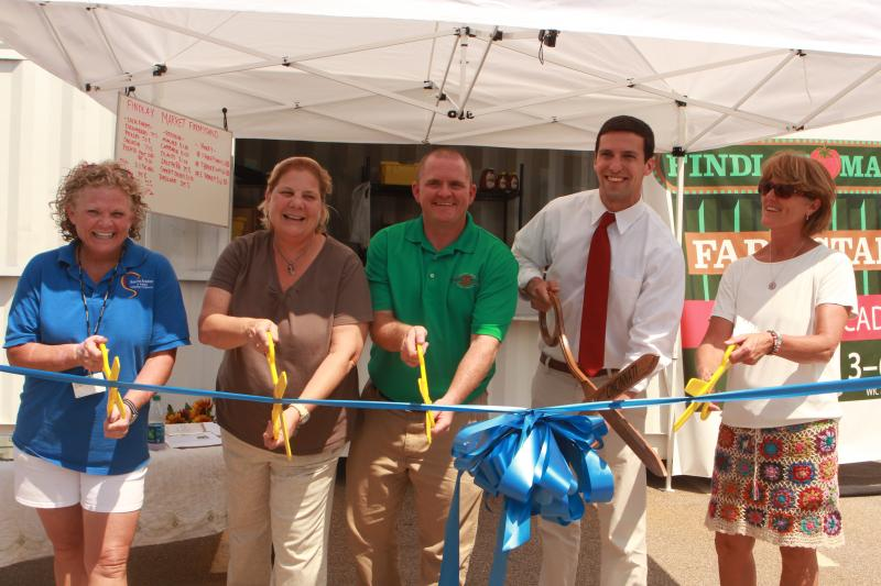 Roberts and Findlay Market staff join City Council member P.G. Sittenfeld for the first farmstand opening Tuesday.