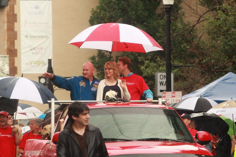 Gabby Giffords and Mark Kelly ride in the Northside Independence Day parade.