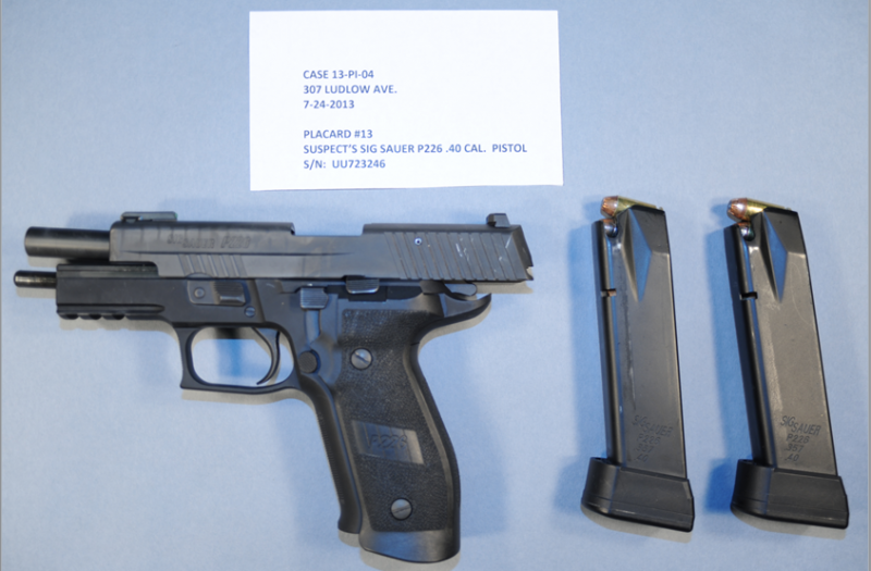 Handgun and ammunition clips that Roger Ramundo was carrying with him during confrontation with police.