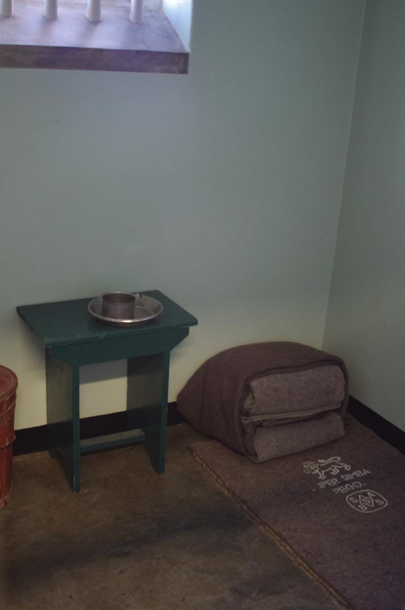 Mandela's small cell contained a bed roll, small table and a bucket for waste. A small, barred window looks out on a high-walled courtyard.