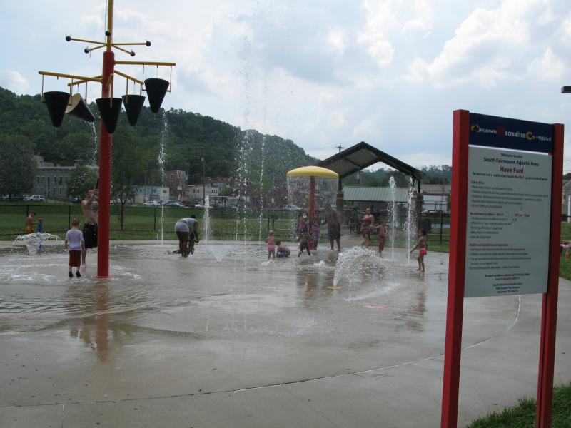 Families play in the water at South Fairmount Aquatic Area.