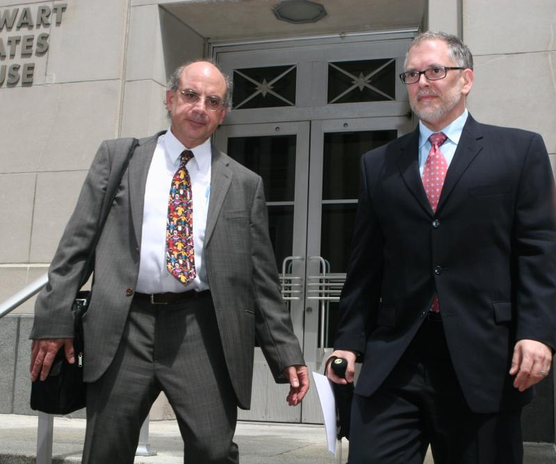 Jim Obergefell (on right) and his attorney Al Gerhardstein exit the federal courthouse after presenting their case Monday.