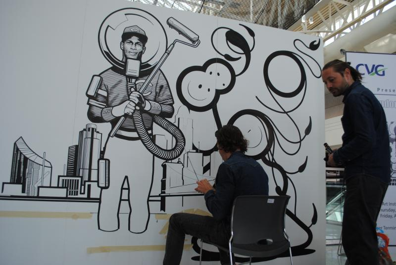 Bob Gibson and Chaz Barrison of The London Police hard at work on thier mural inside CVG