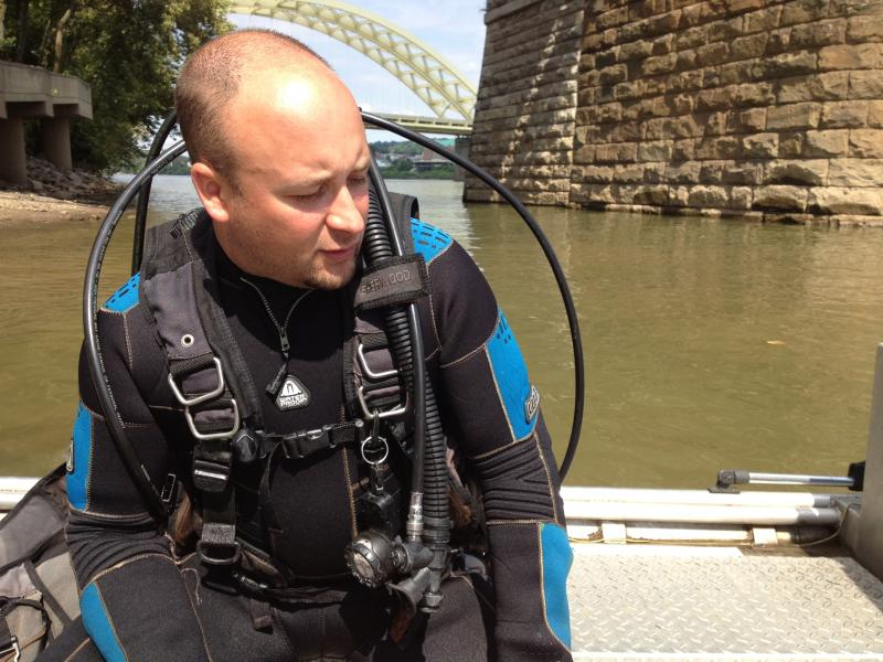 Casey Swecker dives to the bottom of the Ohio to study the mussel concentrations.