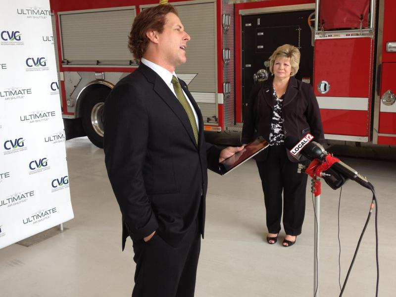 (from left) Rick Pawlak, managing Director of Ultimate Air Shuttle. CVG CEO Candace McGraw stands off to the right.