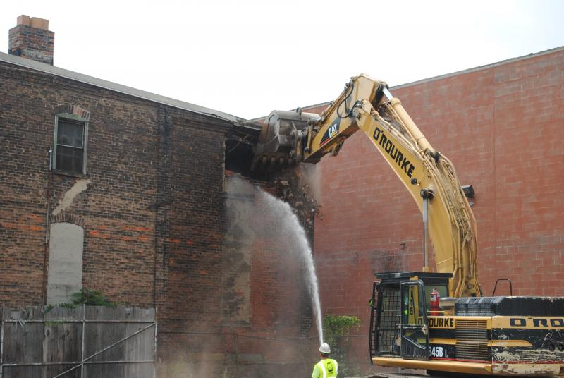 Construction workers begin demolition an Over-the-Rhine building where the city will build a streetcar maintenance facility.