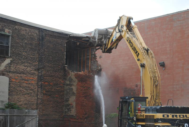 Demolition work underway on an Over-the-Rhine building to clear site of streetcar maintenance building.