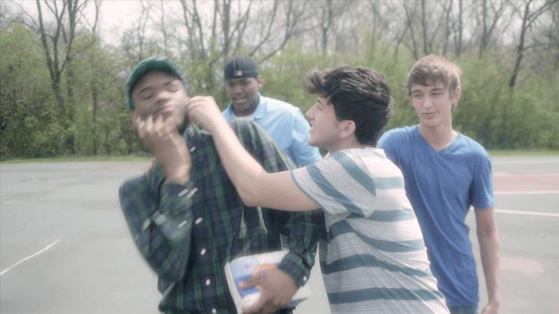 "A picture from the music video ""Stronger"" showing kids bullying."