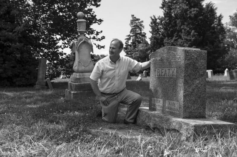 History teacher Paul LaRue at the grave of an African-American Civil War soldier.