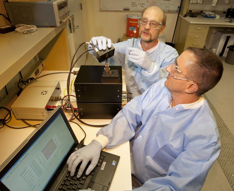 Mechanical engineer Reg Beer (right) and electronics engineer Gary Johnson test a new polymerase chain reaction (PCR) instrument developed at Lawrence Livermore National Laboratory that can process biological samples in less than three minutes.