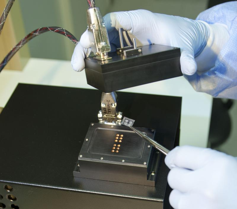 A researcher loads a sample into Lawrence Livermore National Laboratory's new fast polymerase chain reaction (PCR) instrument.