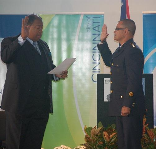 Cincinnati City Manager Milton Dohoney, Jr. administering the oath of office to Police Chief Jeffrey Blackwell.