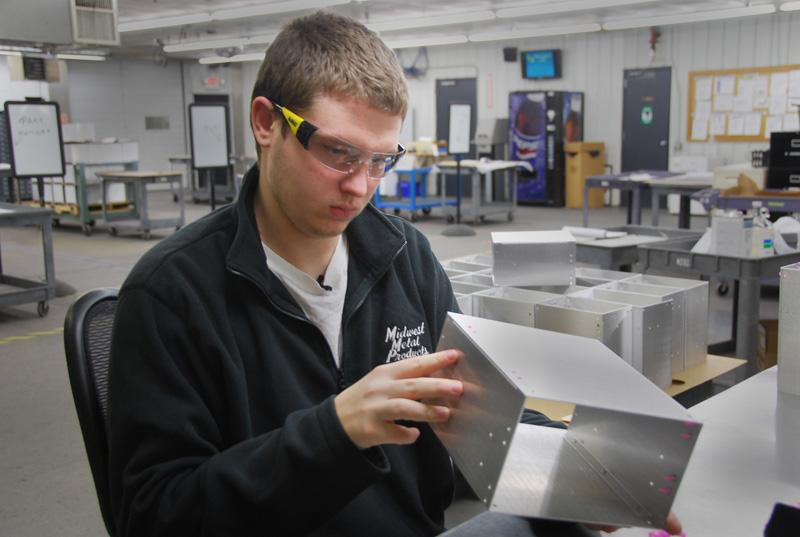 After getting his GED, Josh Woodward took a paid internship at Midwest Metal Products in Cedar Rapids, Iowa. He also enrolled in a machine class at Kirkwood Community College.