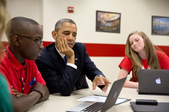 President Barack Obama views student projects created on laptops during a tour of Mooresville Middle School in Mooresville, N.C., June 6, 2013.