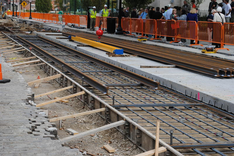 First rails for the streetcar project are installed on Elm Street between 12th and 14th Streets in front of Music Hall.