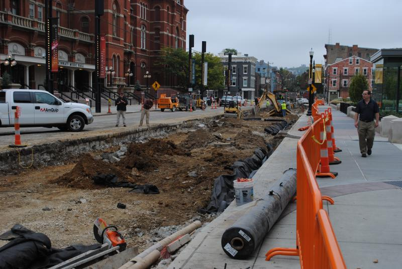 Construction work on Elm Street in front of Music Hall for streetcar project.