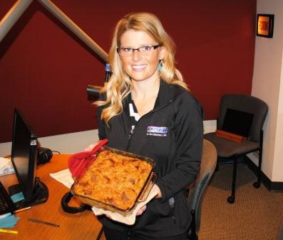 Amy Ott in our studio, holding her Pumpkin Bread Pudding
