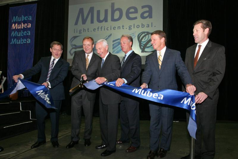Governor Beshear and other officials cut the ribbon for Mubea's new facility.