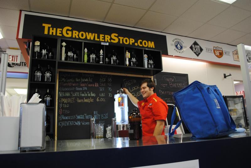 """Billy Beer"" fills up a 32-oz. growler at The Growler Stop in Newtown."