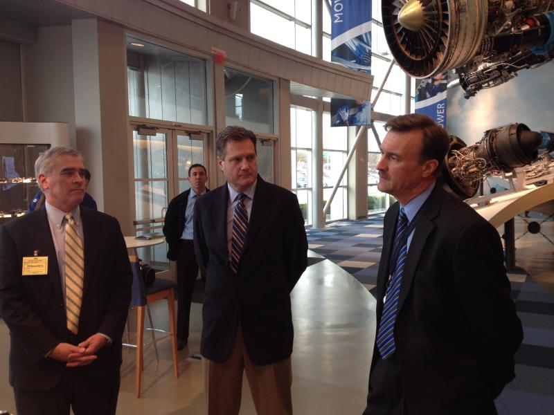 From left: Reps. Brad Wenstrup and Mike Turner and GE's Dan McCormick prepare to witness what GE Aviation says is the first test of aerospace's most advanced  engine.