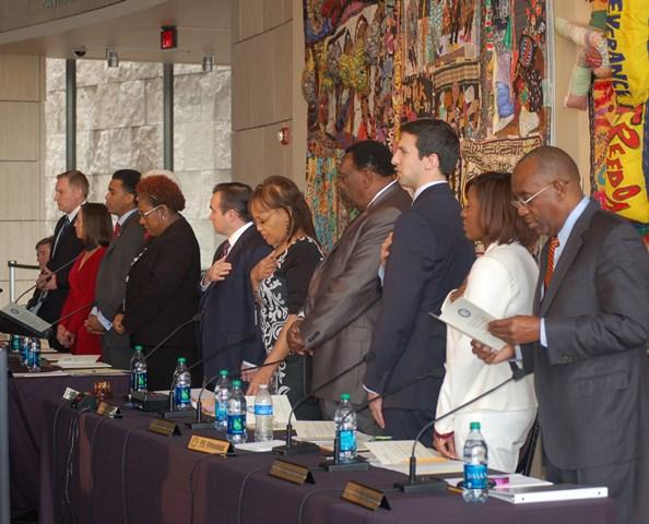 Mayor and council members recite the Pledge of Allegiance during swearing-in ceremony at the National Underground Railroad Freedom Center.