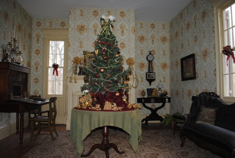 The houses of the Heritage Village Museum are decorated for the holiday, in the style of the period