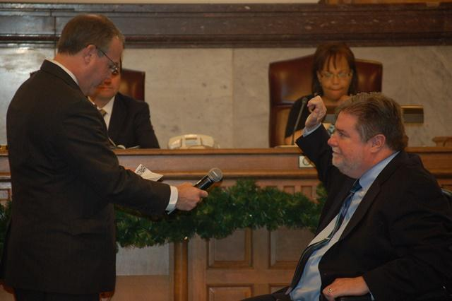 Council member Kevin Flynn takes the oath of office.