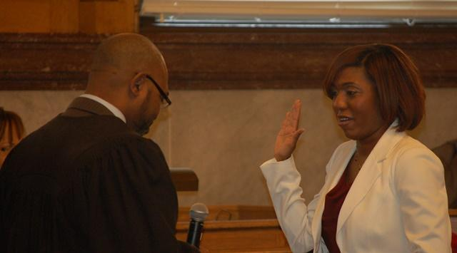 Council member Yvette Simpson takes her oath of office.