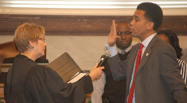 Council member Christopher Smitherman takes his oath of office.