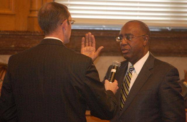 Cincinnati council member Charlie Winburn taking the oath of office.