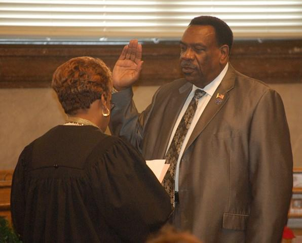 Council member Wendell Young taking the oath of office.