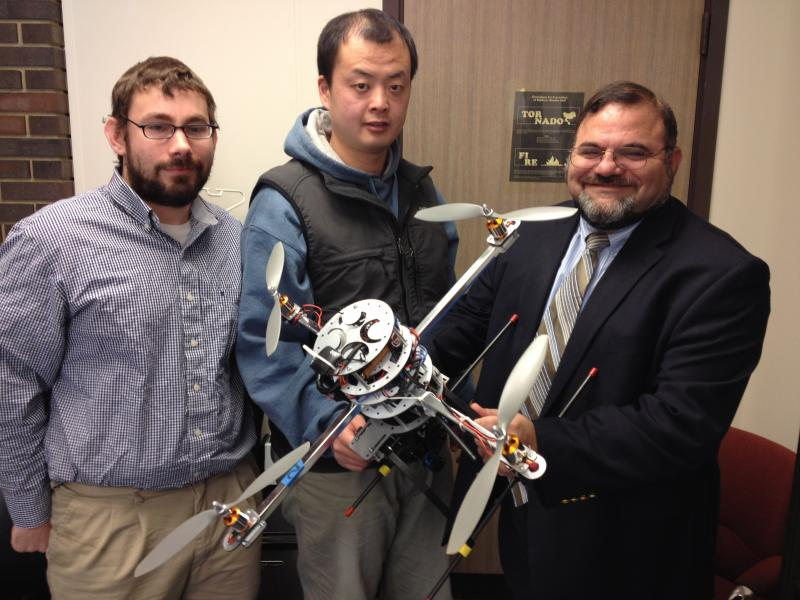 (from left) Graduate students Bryan Brown, Wei Wei, and Professor Kelly Cohen.