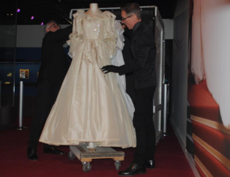 Murton and Grossmark are the only two people in the world allowed to handle the iconic wedding gown.