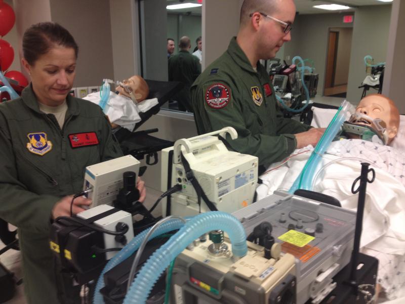Capt. Tammie Canada and Capt. Daniel Bevington tend to a patient.