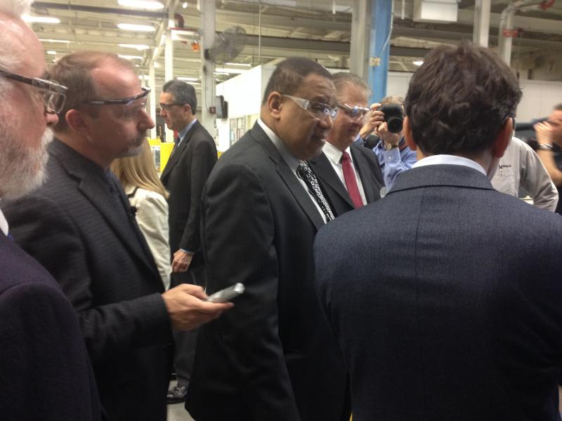 Dr. Odell Owens (center), media and company officials take a tour of the Siemens plant.