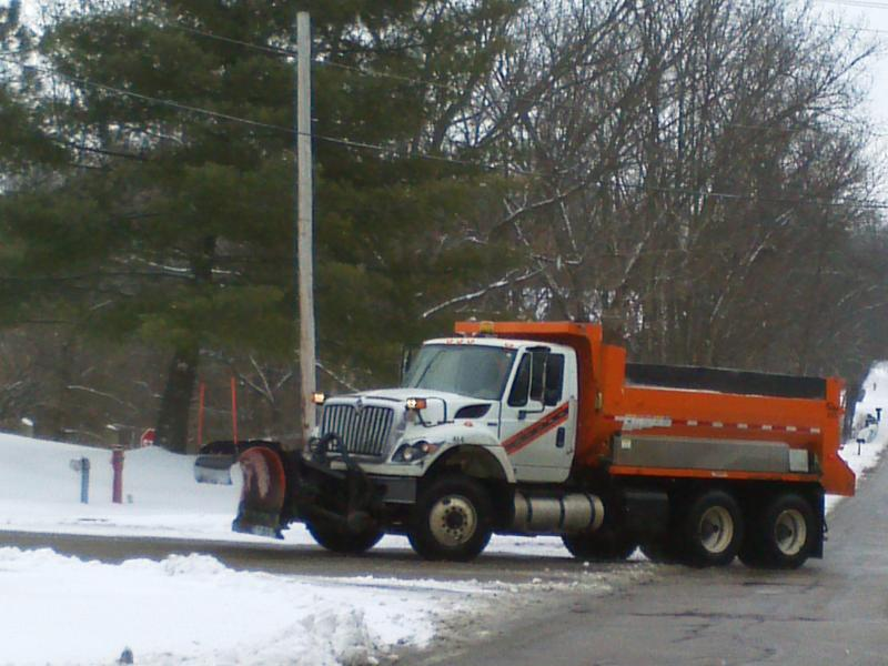A plow driver returns to the salt pile to refill his truck.
