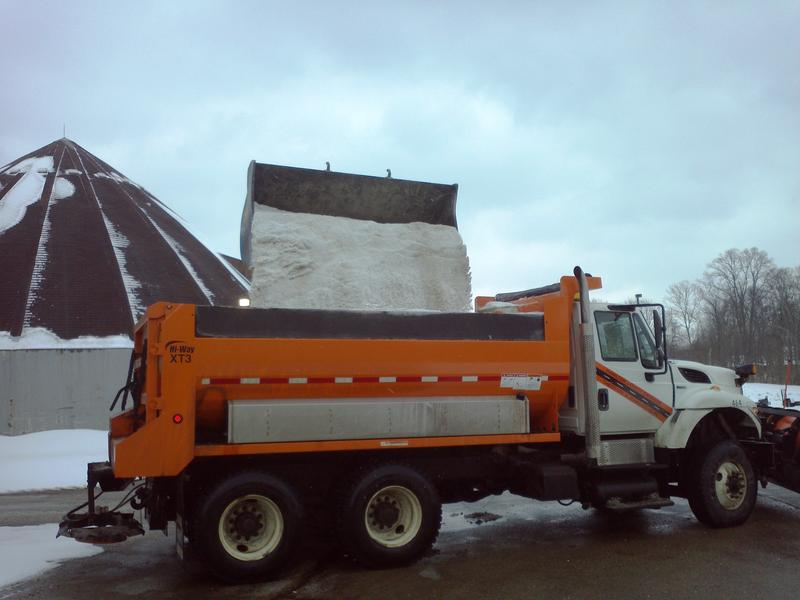 A truck picks up a load of road salt last winter. Prices this year are skyrocketing.