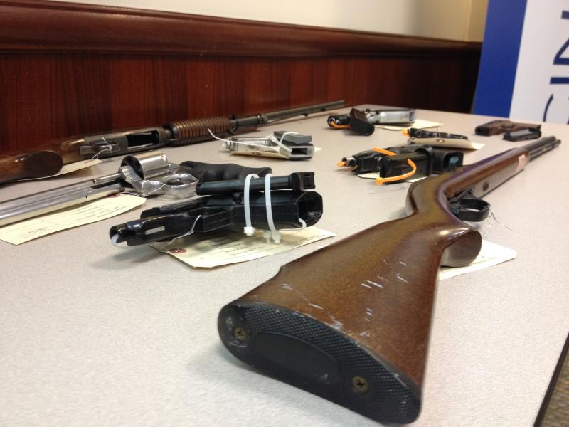 Police displayed several of the weapons seized in the investigation.