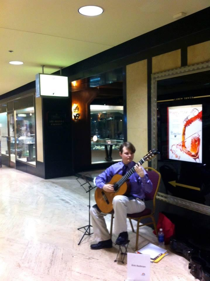 A classical guitarist performs in the arcade at Carew Tower.