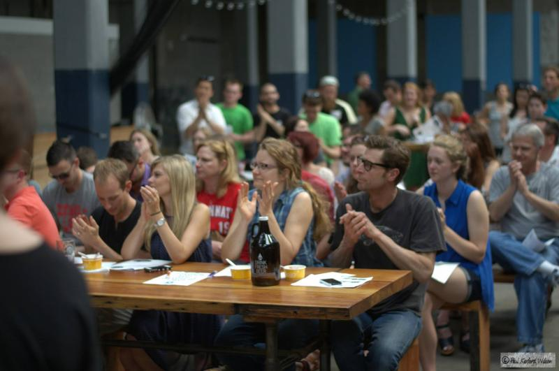 Cincy Sundae attendees at Rhinegeist Brewery listen to four presentations on innovative community ideas and vote on their favorite.