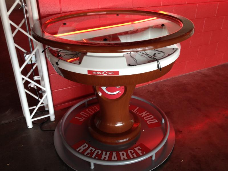 The charging stations appear to be among the most popular things at the Reds Connect Zone.