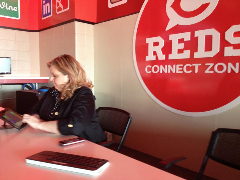 Reds Director of Digital Media Lisa Braun shows off the Reds Connect Zone.