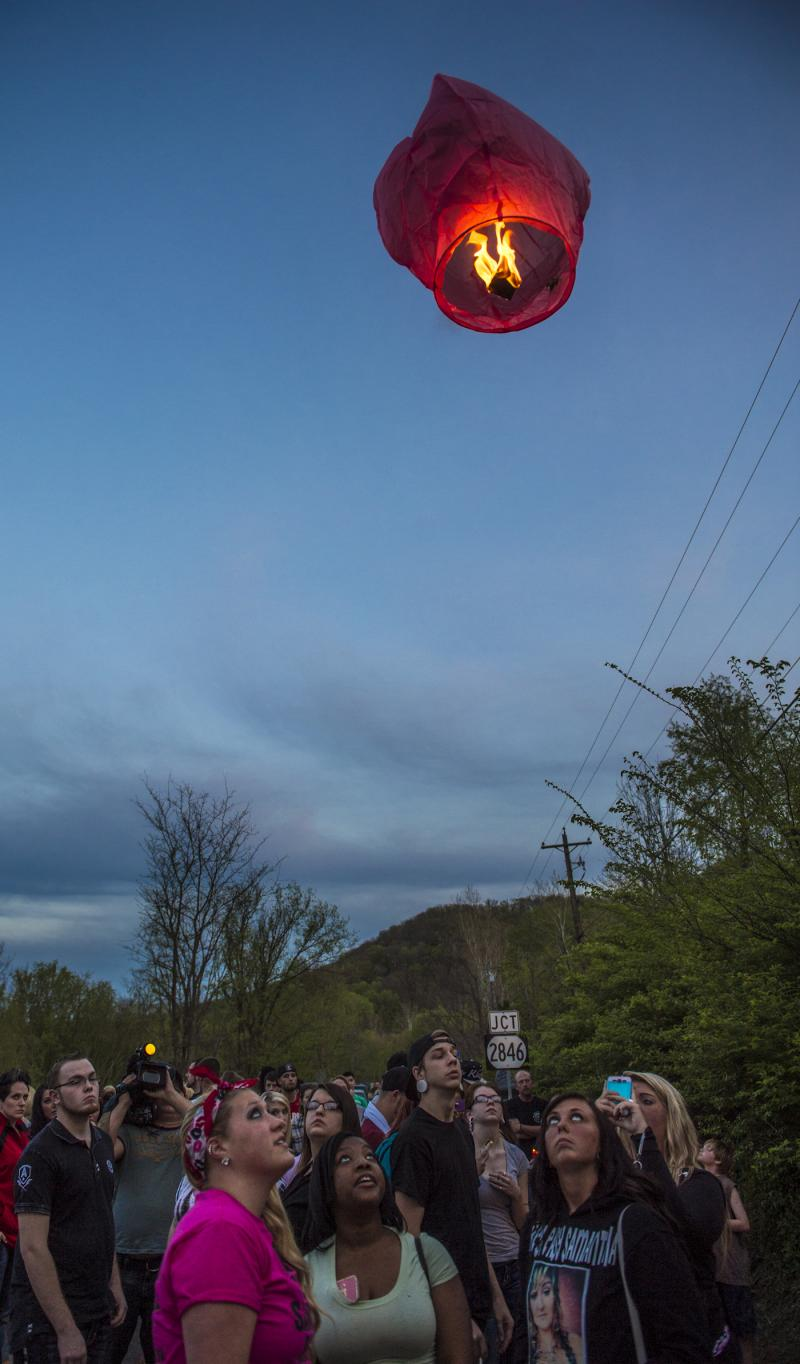 Friends launch a flaming hot air balloon during a roadside vigil for Samantha Ramsey.