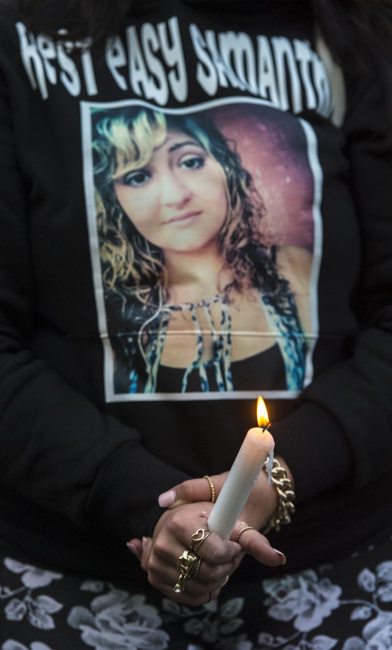 Samantha Ramsey is remembered on a friend's t-shirt during a vigil.